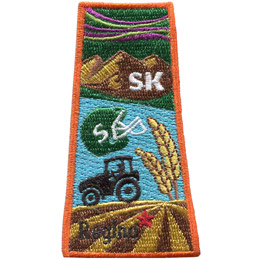 This patch is in the shape of the Canadian province of Saskatchewan. The northern lights,grasslands,mountains,prairies,and lakes are all displayed as well as a tractor and a football helmet.