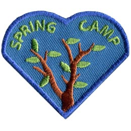 The left heart of the I Love Camping Set is pictured with two tree branches beginning to bud. The words 'Spring Camp' is embroidered on it.