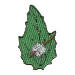 This leaf shaped patch displays a marshmallow skewered on a stick.