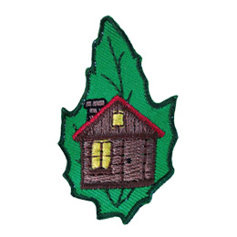 This leaf shaped patch displays a cabin with its windows lit with light.