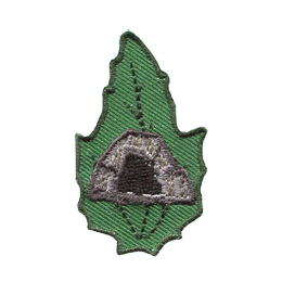 This leaf shaped patch displays a rocky cave opening with a dark center.