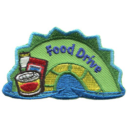 The middle hump of a sea serpent. The words 'Food Drive' are embroidered along the middle of the hump. A can, bag, and carton of food rest on the left most section of the hump.