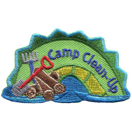 The middle hump of a sea serpent. The words 'Camp Clean-Up' are embroidered along the middle of the hump. A rake, shovel, and a stack of logs rest on the left most section of the hump.