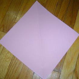 <p>Begin with a square piece of paper. If you are using origami paper, begin with the coloured side down.</p>